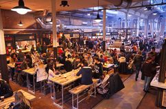 The front section of the Food Hallen. Amsterdam, Netherlands - 21 November, 2015: View of the food hall at the De Hallen event hall on the Bellamyplein Royalty Free Stock Photography
