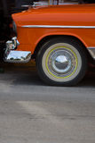 Front section of an old orange vintage car in Miami Stock Image