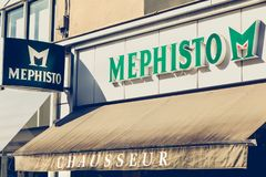 Front of a shoe store of the brand Mephisto. Challans, France - August 11, 2016 : front of a shoe store of the brand Mephisto on a summer day Royalty Free Stock Photography