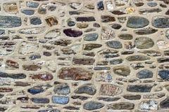 Front shoot of masonry colorful stone wall as texture sample royalty free stock photos