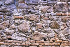 Front shoot of masonry stone wall with blue and yellow lights stock image