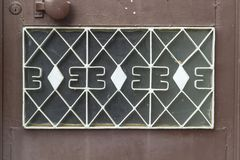 Front shoot of open brown colored metal door part with traditional turkish pattern. Photo has taken in Turkey stock images