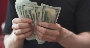 Front shot of man counting three thousand dollars. Wide photo stock photography