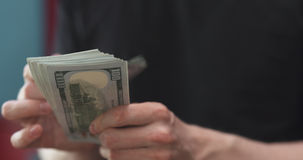 Front shot of man counting three thousand dollars. Wide photo stock photo