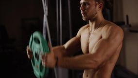 Front shoulder raise with plate stock footage