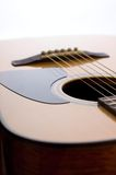 Front side of acoustic guitar with pickguard Stock Photography