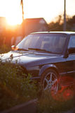 Front side of black old car with beatifull sunset Royalty Free Stock Photography