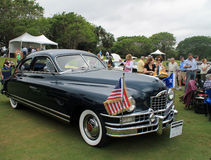 Front side classic american car. Front side angle of classic mid century american car showing grill, front fender, and side. outdoors at event. 1948 Packard stock photography