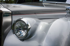 Front side of a classic car. Front of a classic car with headlight and fender Royalty Free Stock Photos