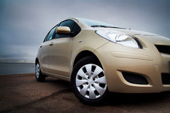 Front-side closeup of a beige car