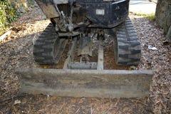 Front Side di un Mini-escavatore Fotografia Stock
