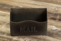 Front side of empty metal mailbox on weather wood royalty free stock photography