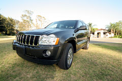 Front side of jeep. Front side of dark gray jeep limited off road vehicle stock images