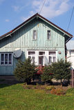 Front side of old village house Royalty Free Stock Image
