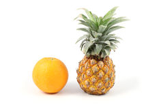 Front side pineapple and orange. On white background Stock Images