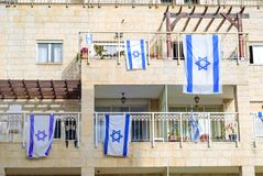 Front side of typical israeli house with israel flags on window. stock images