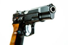 Front side view of black semi automatic pistol royalty free stock photos