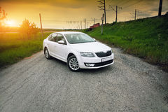 Front-side view of a car. On nature background Royalty Free Stock Image