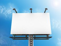 Front side view of a large billboard with lamps against a blue sky Stock Photos