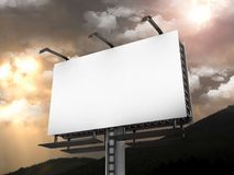 Front side view of a large billboard with lamps against a gray sky Stock Photography