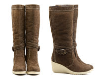 Front and side view of pair of brown female boots stock photo