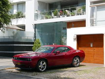 Front and side view of a red mint condition Dodge Challenger SRT8 392 Hemi parked in Miraflores, Lima Stock Photo