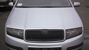 Front side view of silver car stock footage