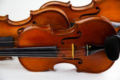 Front side of violin,on background,show body and part on violin. Blurry light around royalty free stock image