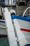 Fisherman boat close up. Front of a small empty fisherman boat moored in port, Greece stock image