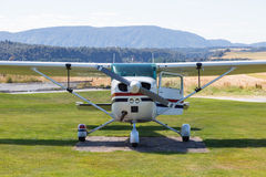 Front of a small plane. Front of a small passenger plane with propeller and open door on a grass airport in the country of New Zealand Stock Photo