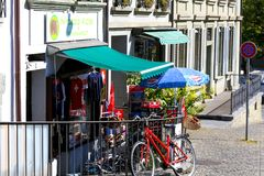 Front of the souvenir shop. Bern, Switzerland - September 25, 2017: In front of the souvenir shop there is a small display of the goods offered. Nearby somebody royalty free stock photography