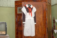 The front Soviet school uniform with a pioneering tie hanging on Stock Images