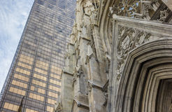 Front of St. Patricks Cathedral and a skyscraper in New York Royalty Free Stock Photos