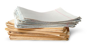 In front stack of old yellowed sheets of school notebooks. Isolated on white background stock images
