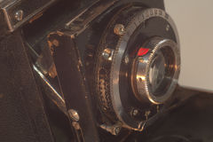 Front stationary lens of vintage folding camera with bellows Stock Images
