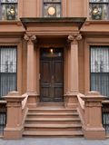 New York brownstone style apartment building. Front steps to New York brownstone style apartment building stock images
