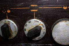 The front of the stove with a potentiometer. With number 100, 150, 200, 250 the strength of fire for cooking royalty free stock image