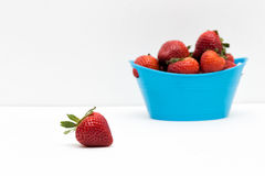 In Front. A strawberry out of basket Royalty Free Stock Image