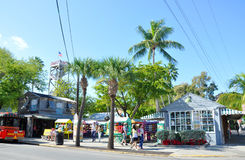 Front Street in Key West, Florida. Shipwreck Museum and colorful shops on Front Street in Key West, Florida, USA Royalty Free Stock Image