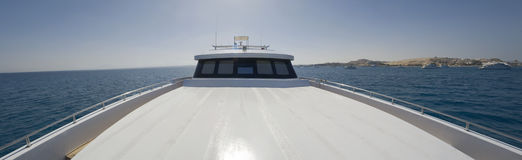 Front sundeck of large motor yacht. Panoramic view of the front sundeck area of a large private motor yacht Stock Photos