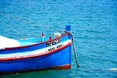 Front of a traditional Dghajsa fishing boat, Malta. Traditional Maltese Dghajsa fishing boat in the harbour, Marsaxlokk, Malta, Europe Royalty Free Stock Images