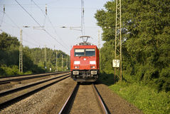 In front of the train. Front of a modern red electric locomotive on the route Stock Image