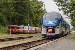 Front of a train proceeding towards a destination. Front of a train captured while proceeding to a destination with another stopped train seen in the background Stock Photo