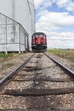 Front of a train on a railway track. Front view of a red and black train on a railway track Stock Image