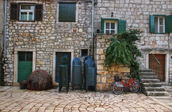 In front of Typical Mediterranean House. Old Fishermen House with Fishing Nets,Chairs and Bicycles stock photos