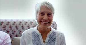 Front view of active Caucasian senior woman sitting in the nursing home 4k