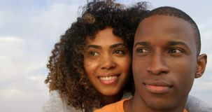 Front view of African American couple embracing each other on the beach 4k. Front view of African American couple embracing each other on the beach. They are stock video footage