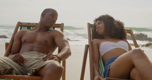 Front view of African american couple interacting with each other on the beach 4k. Front view of African american couple interacting with each other on the beach stock footage