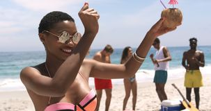 Front view of African American woman dancing on the beach 4k