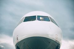 Front view of the airplane. Nose against cloud sky Stock Images